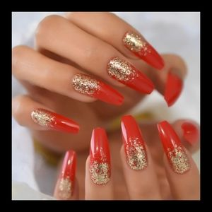Long red and gold coffin shaped nails